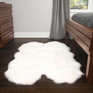 Ilka Faux Fur White Area Rug