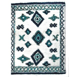 Savings Jarne Tribal Teal/White Area Rug By Union Rustic