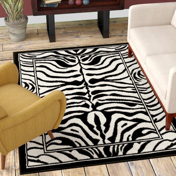 Kaly Zebra Print Ebony Area Rug