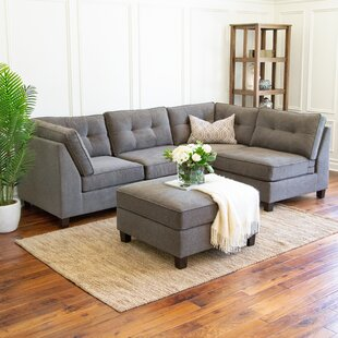https://secure.img1-fg.wfcdn.com/im/75469823/resize-h310-w310%5Ecompr-r85/6040/60408420/lonon-reversible-modular-sectional-with-ottoman.jpg