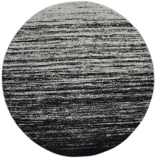 Esther Black Area Rug by Mercury Row