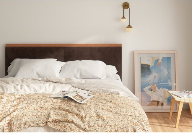Close up of large bed with a bulky comforter and large pillows.