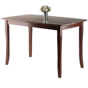 Red Barrel Studio Fetter Solid Wood Dining Table