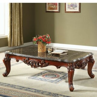 Anner Traditional Rectangular Wood and Marble Coffee Table by Astoria Grand SKU:ED479390 Guide