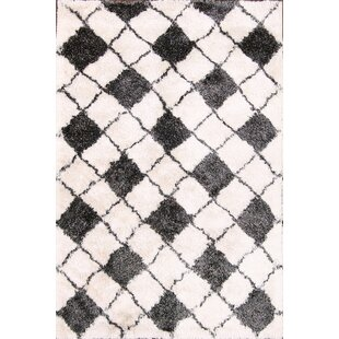 Find the perfect Ilaria Shaggy Modern Oriental Hand-Tufted Black/White Area Rug By Ebern Designs