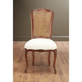 Nia Solid Wood Dining Chair by Alcott Hill