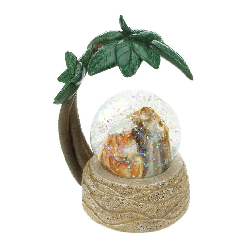 The Holy Family under a palm tree in a globe