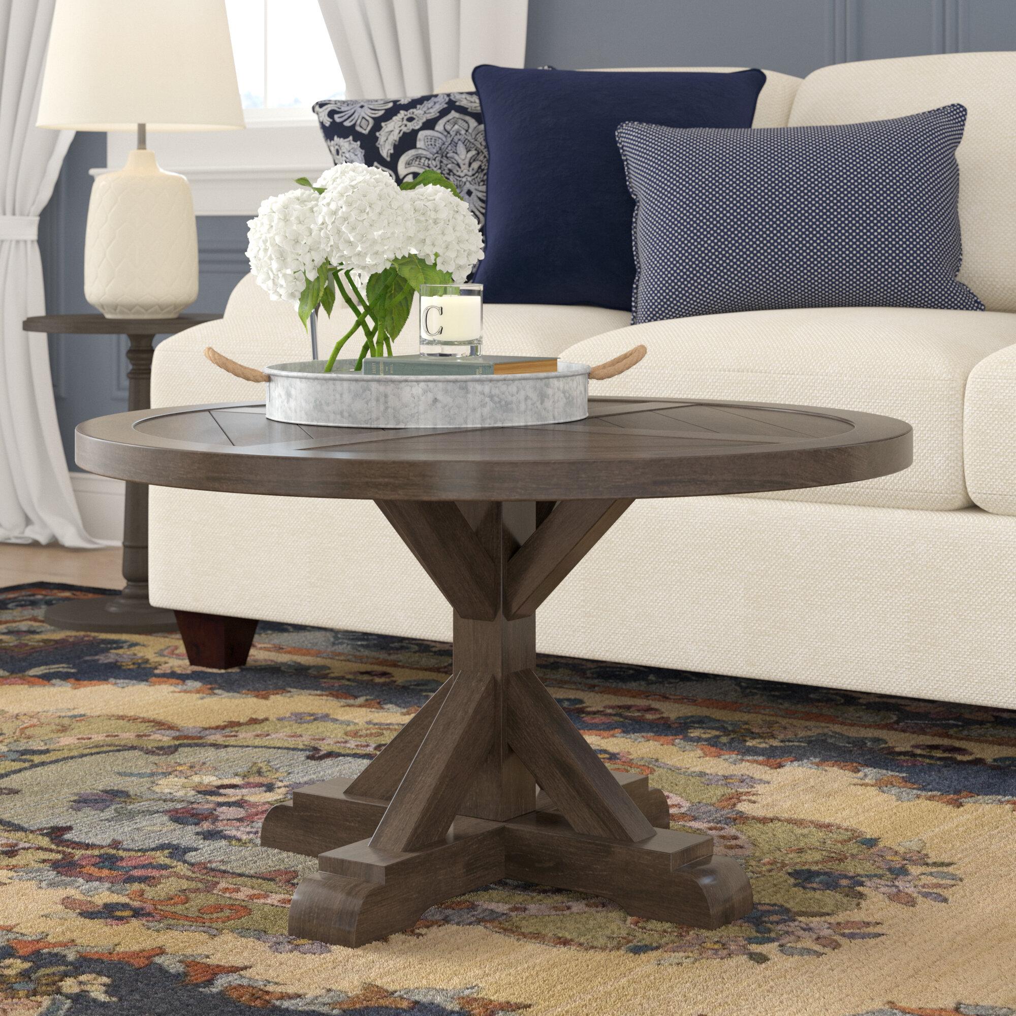 Rosalind Wheeler Isola Pedestal Coffee Table Reviews