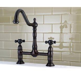 Kingston Brass Duchess Double Handle Centerset Deck Mounted Bridge Faucet