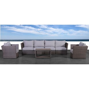 Rosecliff Heights Cody 7 Piece Rattan Sectional Seating Group with Cushions