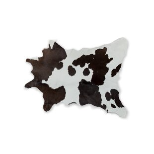 Searching for Hali Hand-Woven Cowhide Chocolate/White Area Rug By Bloomsbury Market