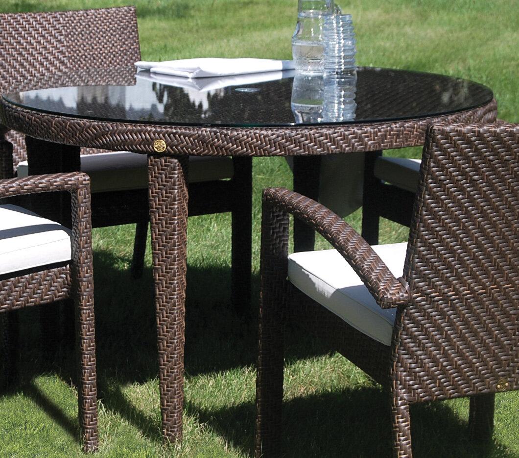 Andover mills ferrero patio woven round dining table with umbrella hole wayfair