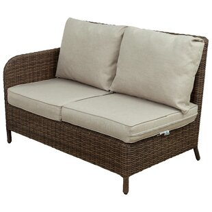 Bavis 4 Piece Rattan Sectional Seating Group with Cushions