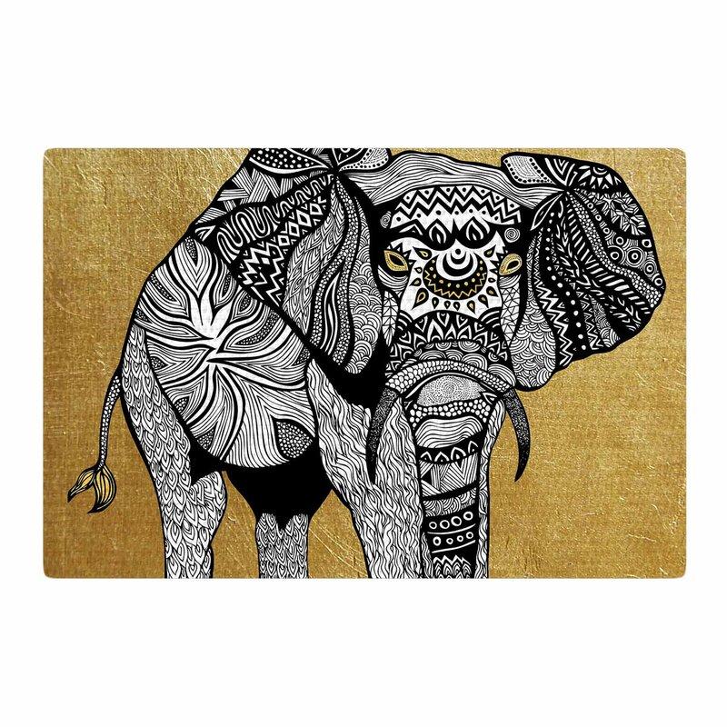 east urban home pom graphic design golden elephant gold/black