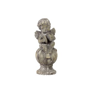 Urban Trends Home and Garden Accents Stoneware Sitting Cupid Statue