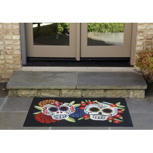 Mr.and Mrs. Muerto Hand-Tufted Black Indoor/Outdoor Area Rug