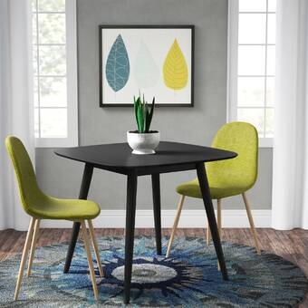 Ebern Designs Pekalongan Mid Century Modern Faux Wood Dining Table