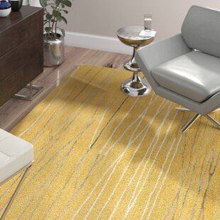 Barbera Hand-Tufted Gold Area Rug by Wade Logan