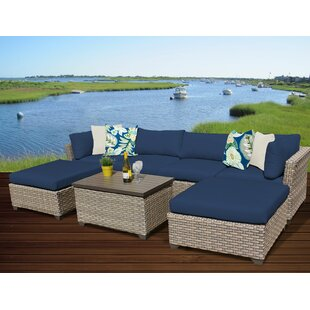 Rochford 7 Piece Rattan Sectional Seating Group with Cushions