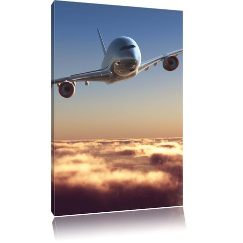 Airplane Above the Clouds Photographic Print on Canvas
