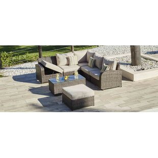 Meunier 7 Piece Rattan Sectional Seating Group with Cushions