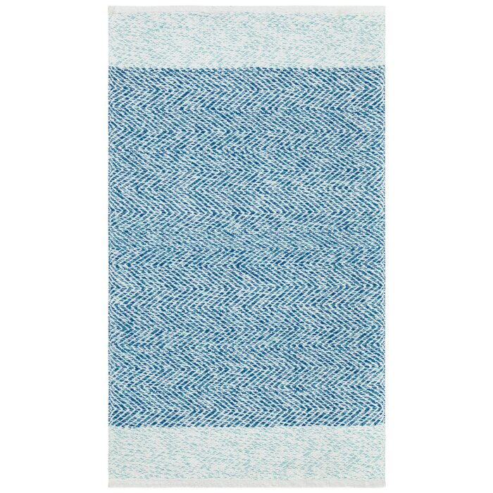 Hunley Hand Tufted Blue Area Rug