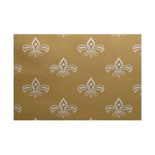 Seline Fleur de Lis Ikat Print Gold Indoor/Outdoor Area Rug