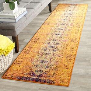 sasha orange area rug