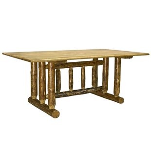 Tustin Trestle Solid Wood Dining Table Loon Peak
