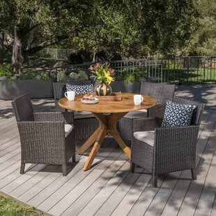 Gracie Oaks Pilcher Outdoor Wicker Rectangular 5 Piece Dining Set with Cushions