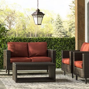 Coast 12 Piece Rattan Sectional Seating Group with Cushions