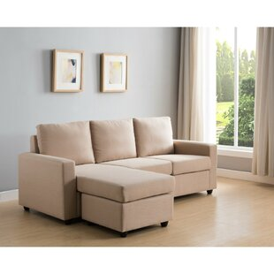Karina Wood and Fabric Reversible Sectional with Ottoman By Wrought Studio