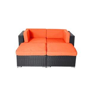 Hibner 4 Piece Rattan Conversation Set with Cushions