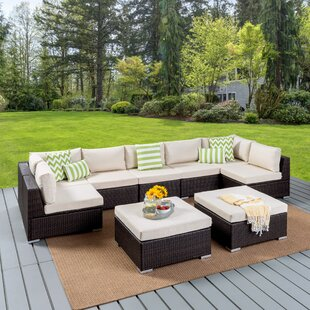 Dicken 9 Piece Rattan Sectional Seating Group with Cushion