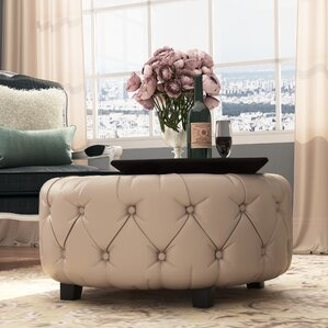 khader leather tufted round ottoman