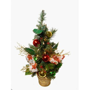 poinsettia and ball ornament pre lit decorated christmas tree