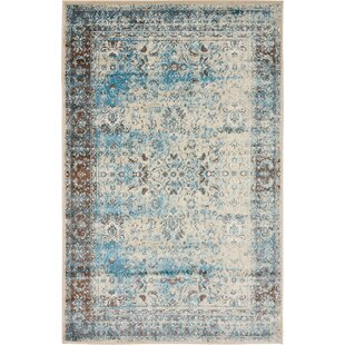 Look for Neuilly Blue/Beige Area Rug By Mistana