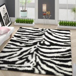Reviews Burns Zebra Print Black/Snow White Shag Area Rug By Zipcode Design