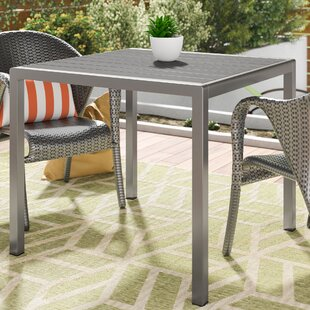 Royalston Manufactured Wood Dining Table ..