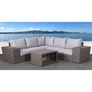 Rosecliff Heights Cody 8 Piece Rattan Sectional Seating Group with Cushions
