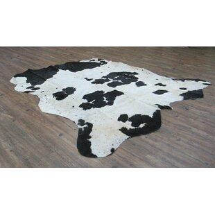 Reviews Valora Hand-Woven Cowhide Black/Off-White Area Rug By Loon Peak