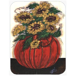Pumpkin Full of Flowers Glass Cutting Board By The Holiday Aisle