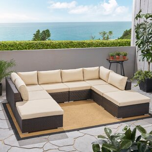 Sedgewick Outdoor 9 Piece Rattan Sectional Seating Group with Cushions