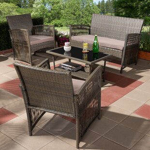 Susan 4 Piece Upholstered Rattan Sofa Seating Group with Cushions