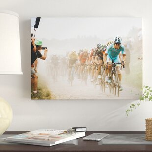 'Cycling in the Dust' Photographic Print on Wrapped Canvas by East Urban Home
