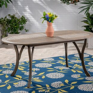 Hoehne Solid Wood Dining Table by Bungalo..
