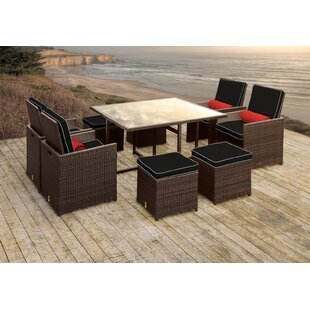 Solis Patio Stella II Patio Rattan 9 Piece Dining Set with Cushions and Cylinder Toss Pillows