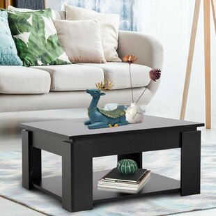 Montagu Distressed Wood Coffee Table by Latitude Run