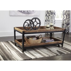 Khue Coffee Table with Magazine Rack by 17 Stories