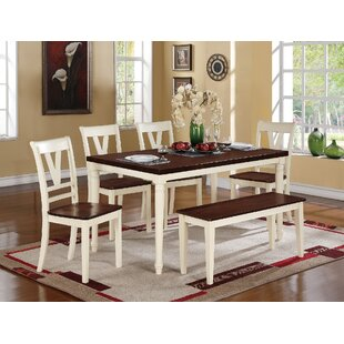 Jeanne Solid Wood Dining Table August Grove